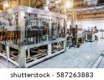 automatic filling machine.... | Shutterstock . vector #587263883