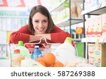 happy woman doing grocery... | Shutterstock . vector #587269388