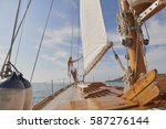 beautiful woman on sailboat in... | Shutterstock . vector #587276144