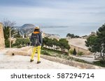 girl looking at the alicante... | Shutterstock . vector #587294714