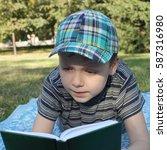cute little boy reading a book... | Shutterstock . vector #587316980