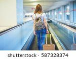 beautiful young tourist girl... | Shutterstock . vector #587328374