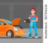 the young male mechanic does... | Shutterstock .eps vector #587356226