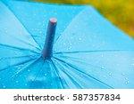 rain drops on a blue umbrella   ... | Shutterstock . vector #587357834
