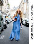 Small photo of PARIS-JULY 8, 2015. Art director and buyer Elina Halimi is going to a fashion show. Paris fashion week.