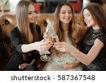 cheerful girls clinking glasses ... | Shutterstock . vector #587367548