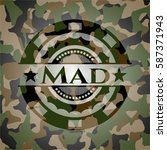 mad on camouflage texture | Shutterstock .eps vector #587371943
