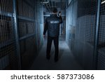 rear view of a security guard... | Shutterstock . vector #587373086