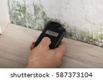 Person Hand Measuring The...