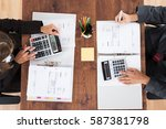 two accountants calculating tax ... | Shutterstock . vector #587381798