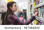 woman buys spice in supermarket ... | Shutterstock . vector #587386820