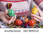 colored easter eggs with... | Shutterstock . vector #587389010
