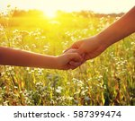 hands of holding each other in... | Shutterstock . vector #587399474