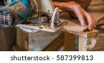 a man cuts a board manual... | Shutterstock . vector #587399813