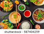 asian food served on black... | Shutterstock . vector #587404259