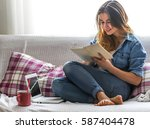 white cozy bed and a beautiful... | Shutterstock . vector #587404478