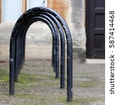 Small photo of Jowett Walk, Oxford, United Kingdom, February 19, 2017: Empty black painted bicycle parking metal frames on the street in Oxford, England
