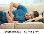 handsome young man suffering... | Shutterstock . vector #587451794