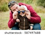 dad wears sunglasses to his... | Shutterstock . vector #587497688