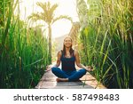 young woman practicing yoga... | Shutterstock . vector #587498483