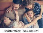 happy family at home spending... | Shutterstock . vector #587531324