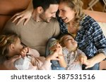 happy family at home spending... | Shutterstock . vector #587531516