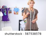 young fashion designer working... | Shutterstock . vector #587538578