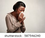 sneezing black woman | Shutterstock . vector #587546240