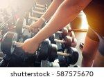 sport girl holding weight on...   Shutterstock . vector #587575670