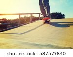 young skateboarder legs riding... | Shutterstock . vector #587579840
