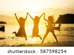 group of girls jumping on the... | Shutterstock . vector #587598254