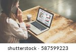 young businesswoman sitting at... | Shutterstock . vector #587599223