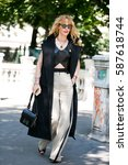 Small photo of PARIS-JULY 6, 2016. Art director and buyer Elina Halimi is going to a fashion show. Paris fashion week.