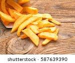 fried potatoes on a wooden...   Shutterstock . vector #587639390