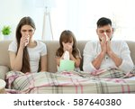 ill family sitting on sofa at... | Shutterstock . vector #587640380