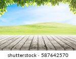 wood table top on mound slope... | Shutterstock . vector #587642570