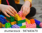 kid playing in construction set | Shutterstock . vector #587683670