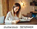 modern woman reading magazine... | Shutterstock . vector #587694404