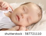 cute sleeping baby with mother... | Shutterstock . vector #587721110