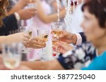 guests drink champagne at a... | Shutterstock . vector #587725040