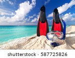 Snorkeling mask and fins on the tropical beach - stock photo