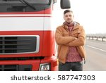 handsome driver near big modern ... | Shutterstock . vector #587747303