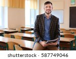 Portrait Of Happy Teacher In...