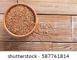 brown flax seeds on a wooden... | Shutterstock . vector #587761814
