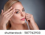 middle aged women try to see... | Shutterstock . vector #587762933