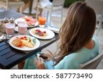 woman eating breakfast at the