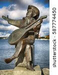 Small photo of STOCKHOLM, SWEDEN - AUGUST 19, 2016: View of Evert Taube monument with guitar on Gamla stan in Stockholm, Sweden in Stockholm, Sweden on August 19, 2016.