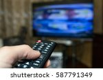 watching tv and using remote... | Shutterstock . vector #587791349