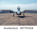 Small photo of Aggressor fighter jet reflects the sunshine. military aircraft parked in the airport.
