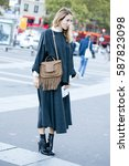 Small photo of PARIS-SEPTEMBER 30, 2015. Stylist Alexandra Golovanoff is going to a fashion show. Paris fashion week.
